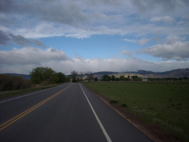 [Mile ~55, 7:58 a.m.] Riding towards the mountains northwest of Boulder.