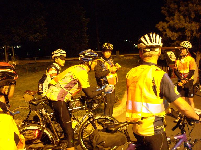 [Mile 0, 3:58 a.m.] A couple dozen brevet riders were at the Louisville start, with John Lee Ellis giving final ride tips.