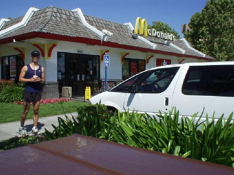 "[Mile 23.3, 10:40 a.m.] Now in ""troubled"" territory.  However, whether it be East Palo Alto (as here) or France, McD's has been there in my time of need.  Here I am with a vanilla milkshake that really energized me for"