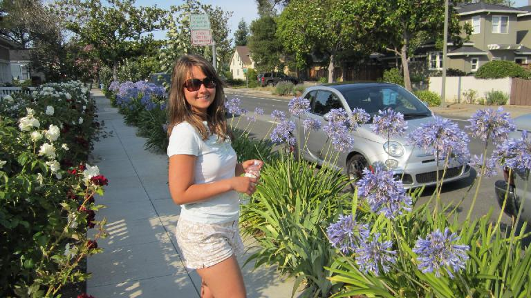 Katia with our Fiat 500 rental car on the block over from the HP Garage.