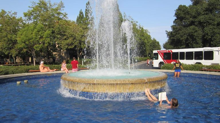 At Stanford, people need to study a lot... even while they relax in a fountain on a hot day.
