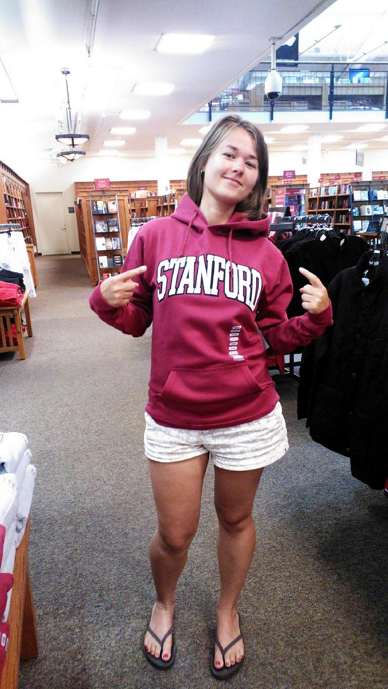 Katia trying on a Stanford sweatshirt.