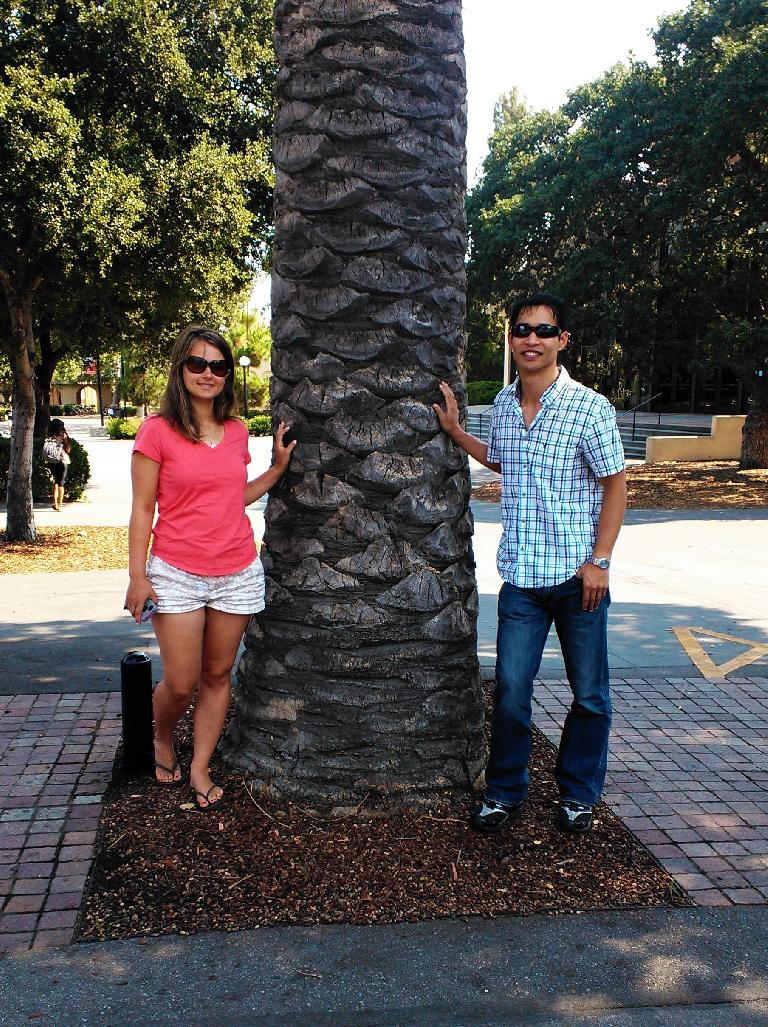With a palm tree outside Tressider Union.