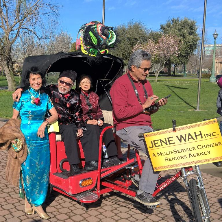 Sylvia Wong with the Jene Wah Seniors Agency cycle in the 2017 Stockton Chinese New Year parade.