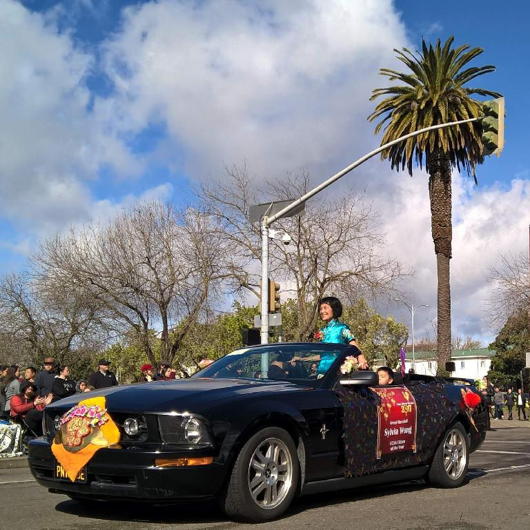 Sylvia Wong, Citizen of the Year, in the black Mustang convertible used in the 2017 Stockton Chinese New Year parade.