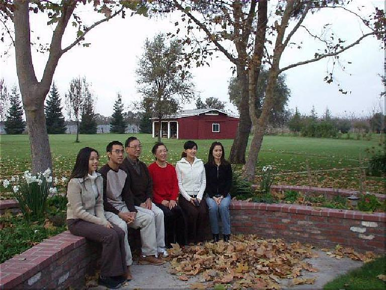 The Tse family in my parents' back yard, comprising of a couple of acres of grass and... a barn.  The Tses got all the good-looking genes in my family...
