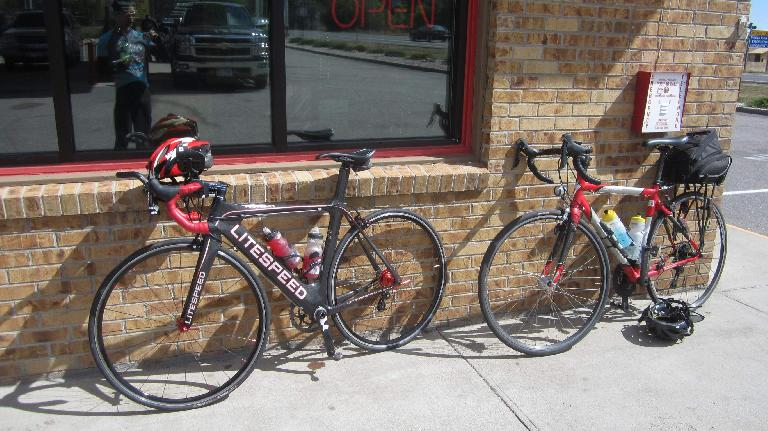 [Mile 93.6, 2:11 p.m.] My black Litespeed Archon C2 and a red and silver aluminum alloy Specialized Sequoia.