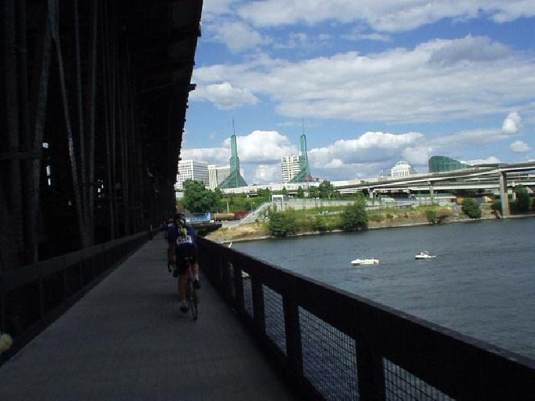 [Day 2, Mile 200, 4:22pm] 6 miles from the finish in Portland, Kevin and I really hammered all the way until around this point.  Here's Kevin on a bike bridge over the Willamette River. (July 13, 2003)