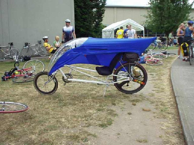 [Day 2, Mile 176, 1:14 p.m.] Another faired recumbent, probably a Gold Rush. (July 13, 2003)