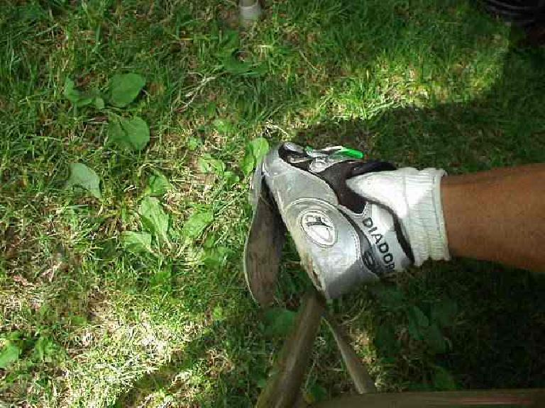My shoe had almost completely fallen apart in the last few legs of the ride.  Makes me wonder how much farther I would have gone before the cleat separated from the shoe!. (July 13, 2003)