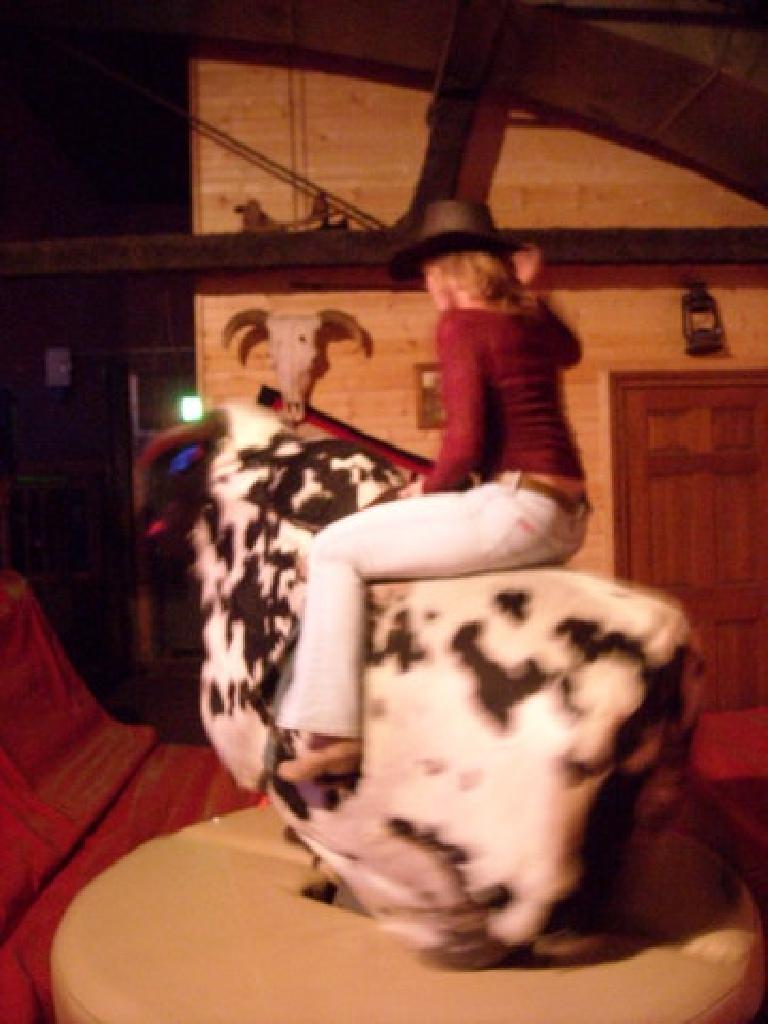 Tanya riding the mechanical bull.  She hung on for nearly a minute.