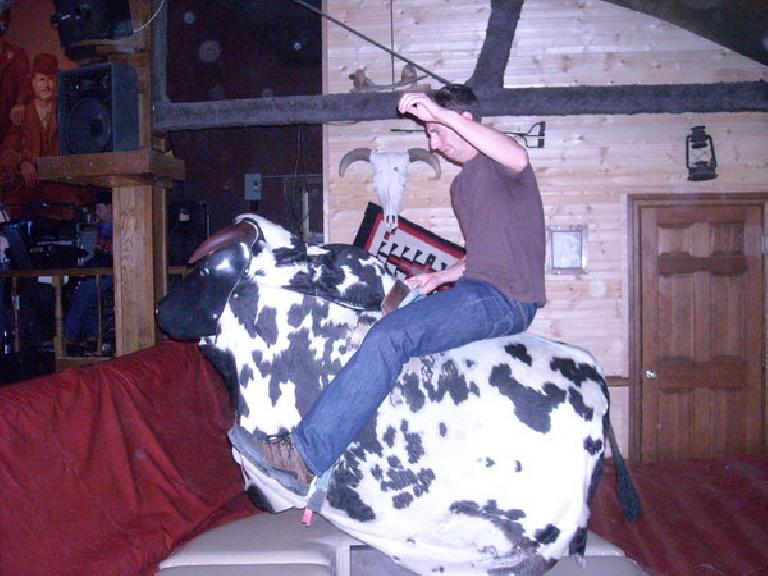 Jon riding the bull.