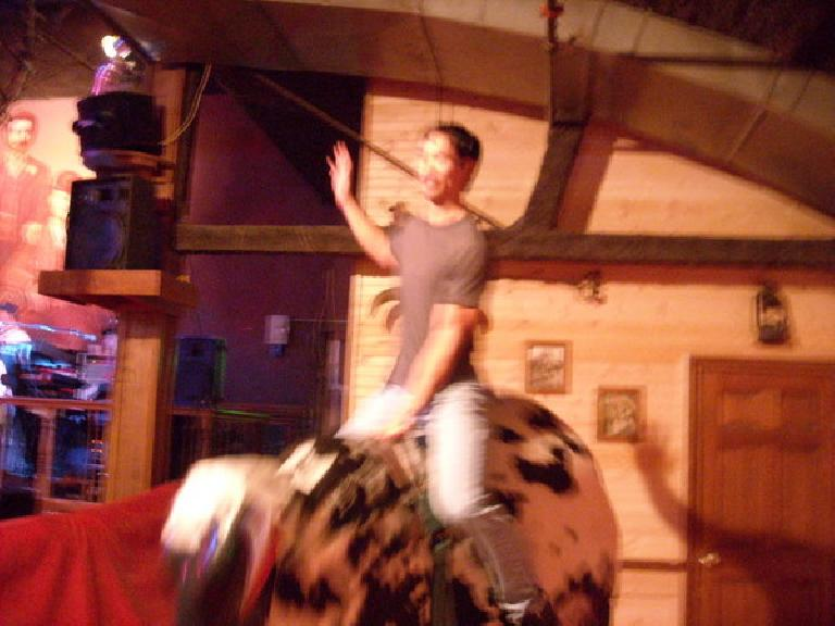 Felix Wong riding the bull.