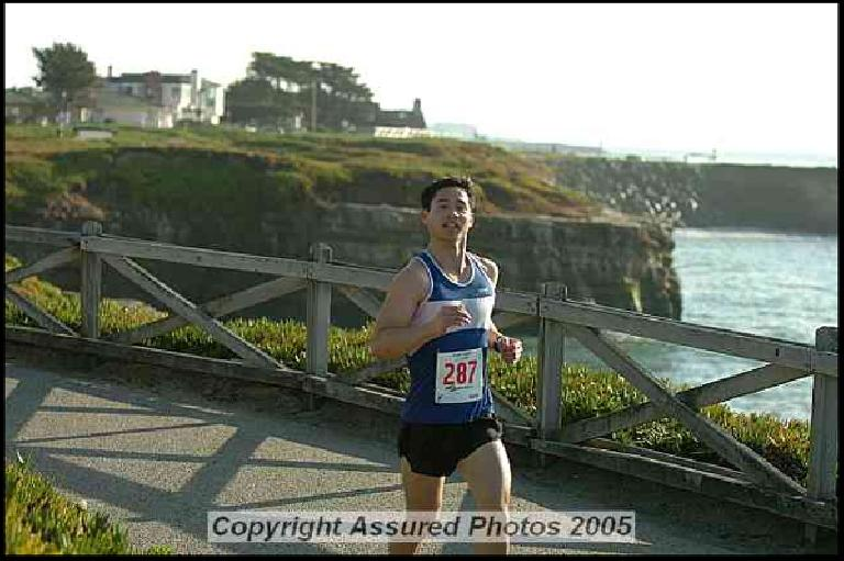 Felix Wong running on the course, which had some nice views of the Pacific Ocean.  Photo: assuredphotos.com.