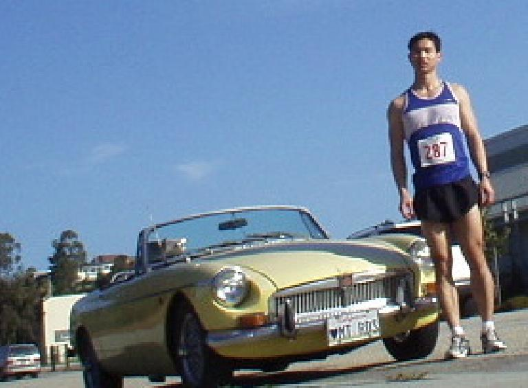 Felix Wong and Goldie, who got the pleasure of driving up Highway 17 from Fremont to Santa Cruz today.  No sweat for the MG...