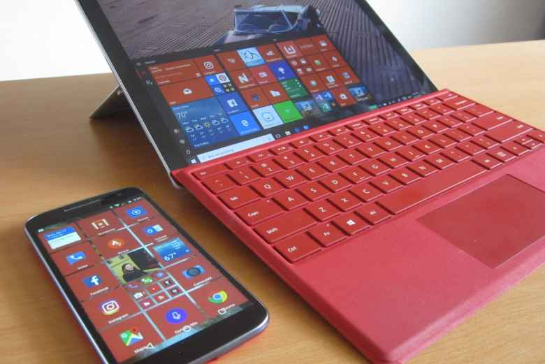 red Moto G4 with SquareHome 2, red Microsoft Surface Pro 4