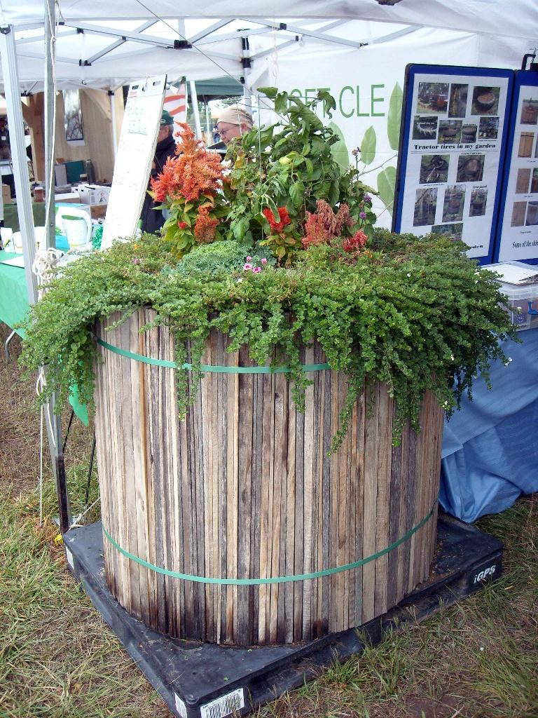 A portable planter made from tractor tires hidden within.