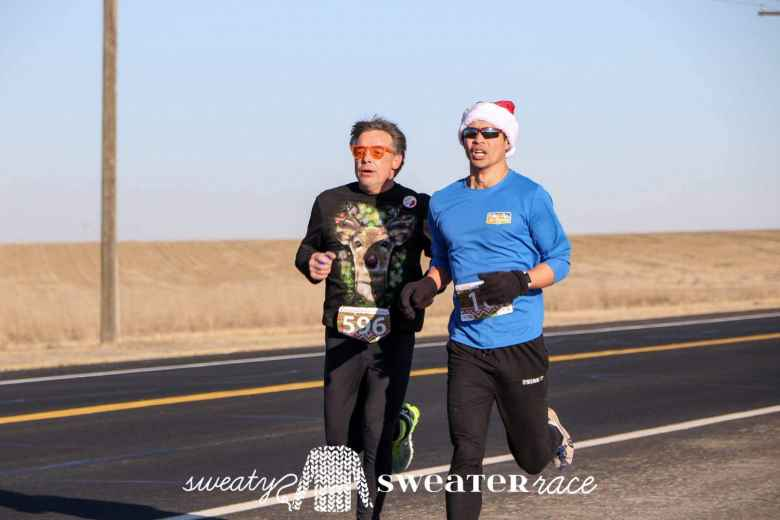 James Cotter and Felix Wong briefly running side-by-side during the Sweaty Sweater 4 Mile.