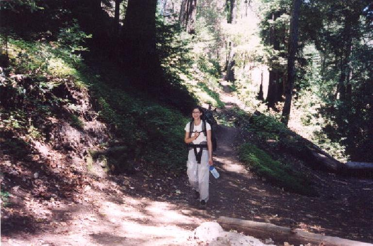 Sarah coming down the trail at approximately Mile 6.