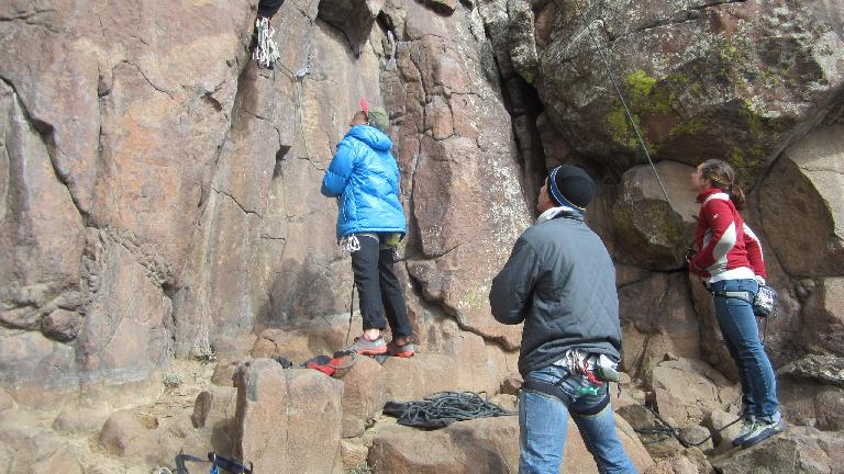 Jordan and Erika on belay with Scott looking on.
