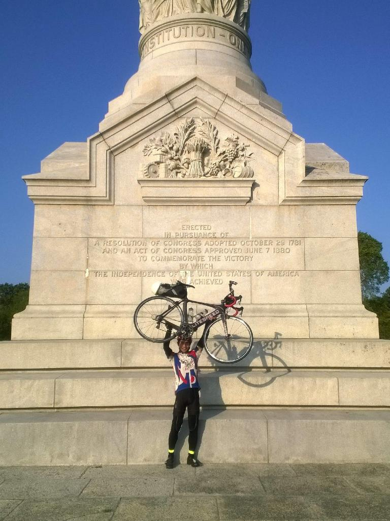 Felix Wong finishing the 2015 Trans Am Bike Race at the Yorktown Victory Monument in Virginia.