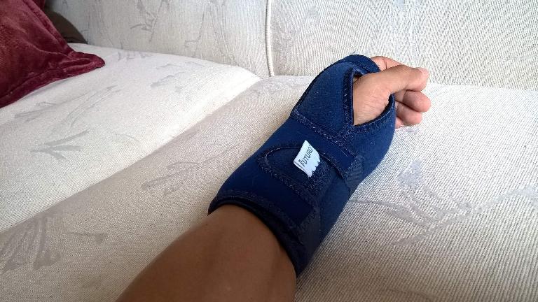 left arm, carpal tunnel syndrome, blue splint, numb hands, Trans Am Bike Race