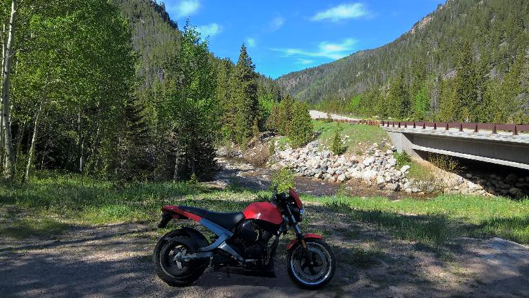 Felix Wong's red 2003 Buell Blast in the Poudre Canyon.
