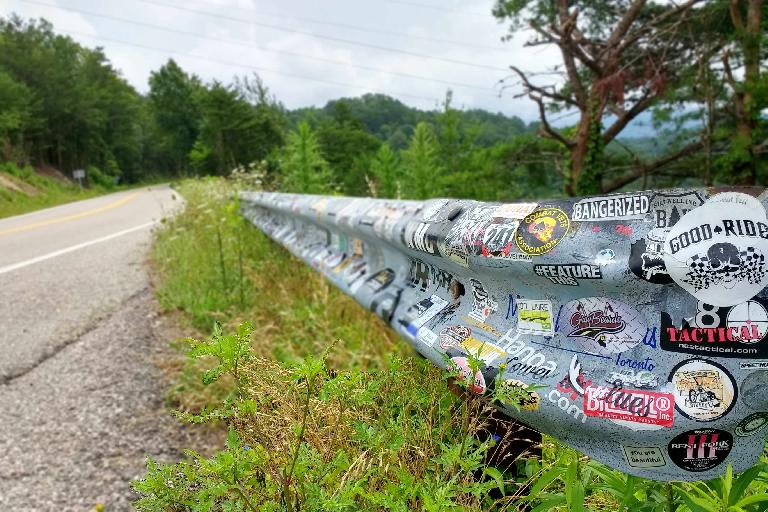 Bumper stickers on a guard rail near a scenic overlook off the Tail of the Dragon on Rt. 129.