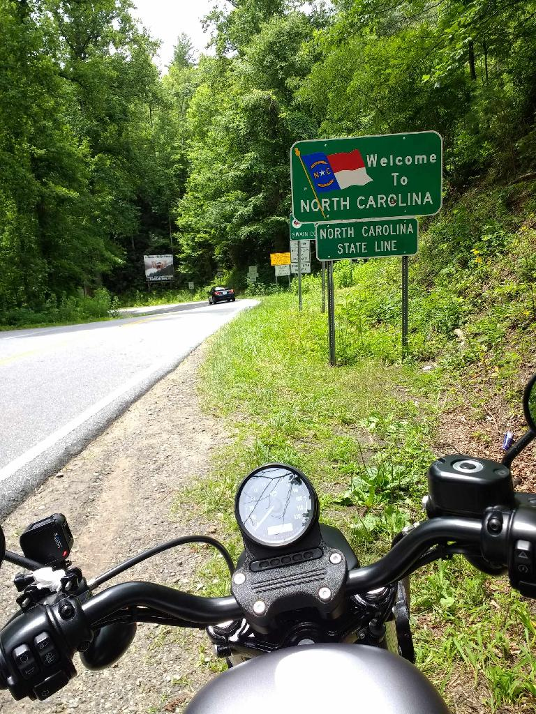 """Welcome to North Carolina"" sign on the Tail of the Dragon on Rt. 129."