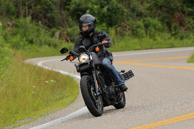 Felix Wong riding a Charcoal Denim Harley-Davidson Sporster Iron 883 on the Tail of the Dragon (Rt. 129).
