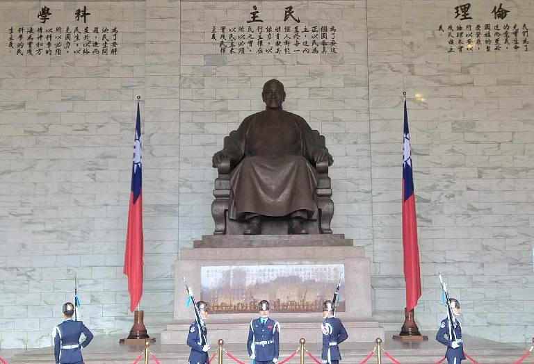 Changing of the guard in front of a giant statue of Chiang Kai-shek.
