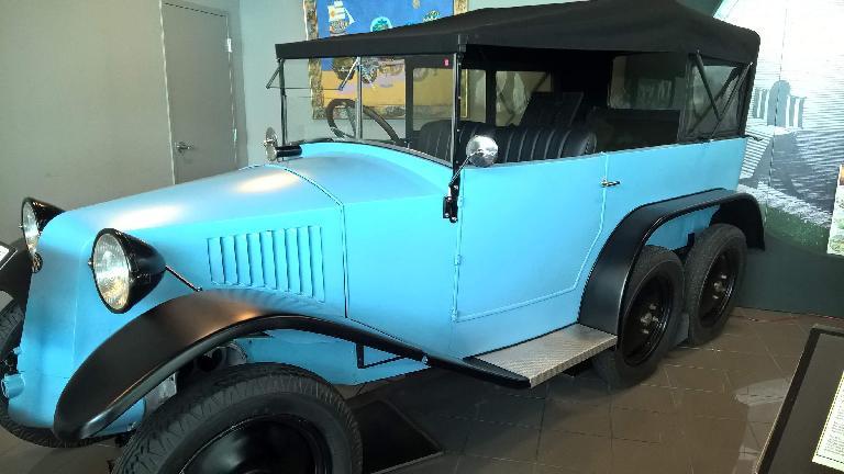 A blue Tatra T26-30 six-wheeler.  Tatra is a company in the Czech Republic that still makes trucks today.