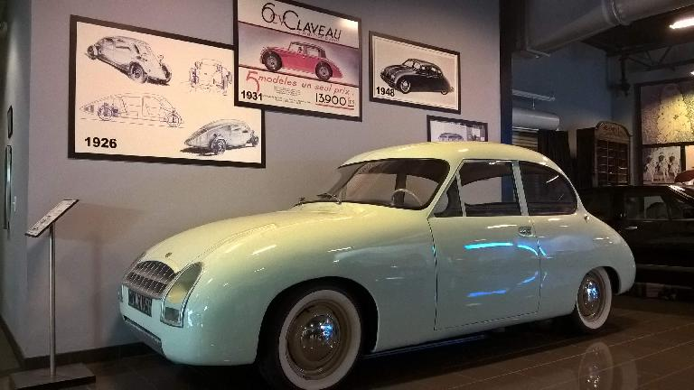 """A yellow 1956 Claveau front-wheel-drive vehicle that used """"anneaux Neiman"""" rubber rings in rings that provided the suspension."""