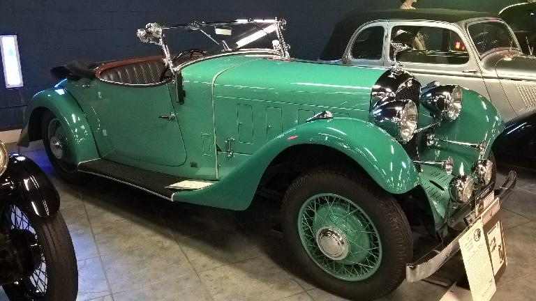 A green 1933 Derby L8 Roadster. Derby was a French company that made race cars.