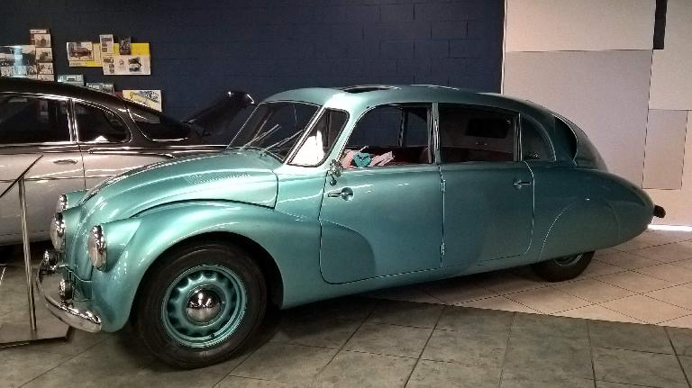 The Tatra T87 was made from 1937-1948 and featured a rear 75-hp V8 and independent suspension.  It had a tendency to oversteer dangerously.