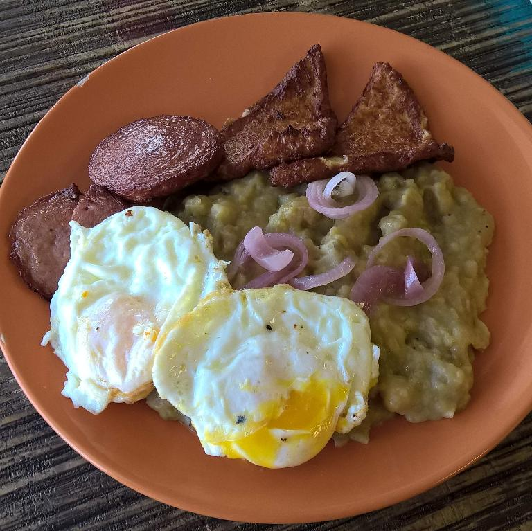 """Tres golpes"" (""three hits"") at the Mangú Latin Restaurant in Brandon, Florida included eggs, sausage, fried cheese and mashed plantains."