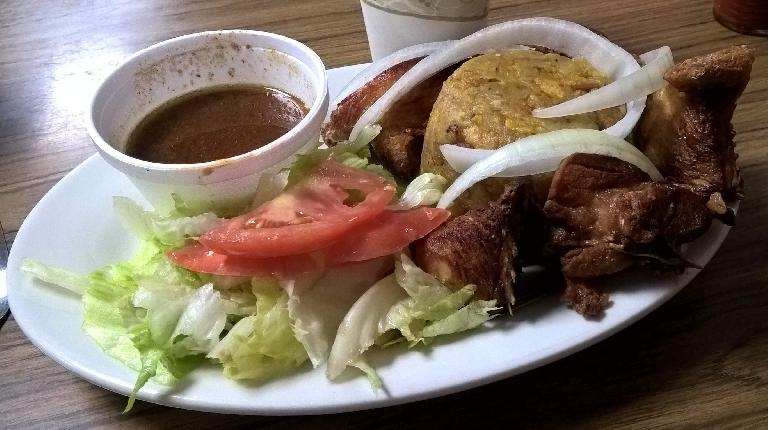 Mofongo (Puerto Rican plantains), chicken, and salad at La Lechonera in Tampa, Florida.