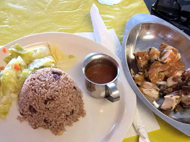 Cabbage, brown rice, and jerk chicken at the Jerk Center in Palm Harbor, Florida.