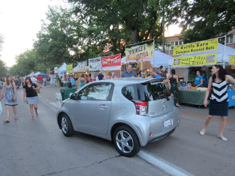 Scion IQ.  It is the same size as a Smart car but has four seats.