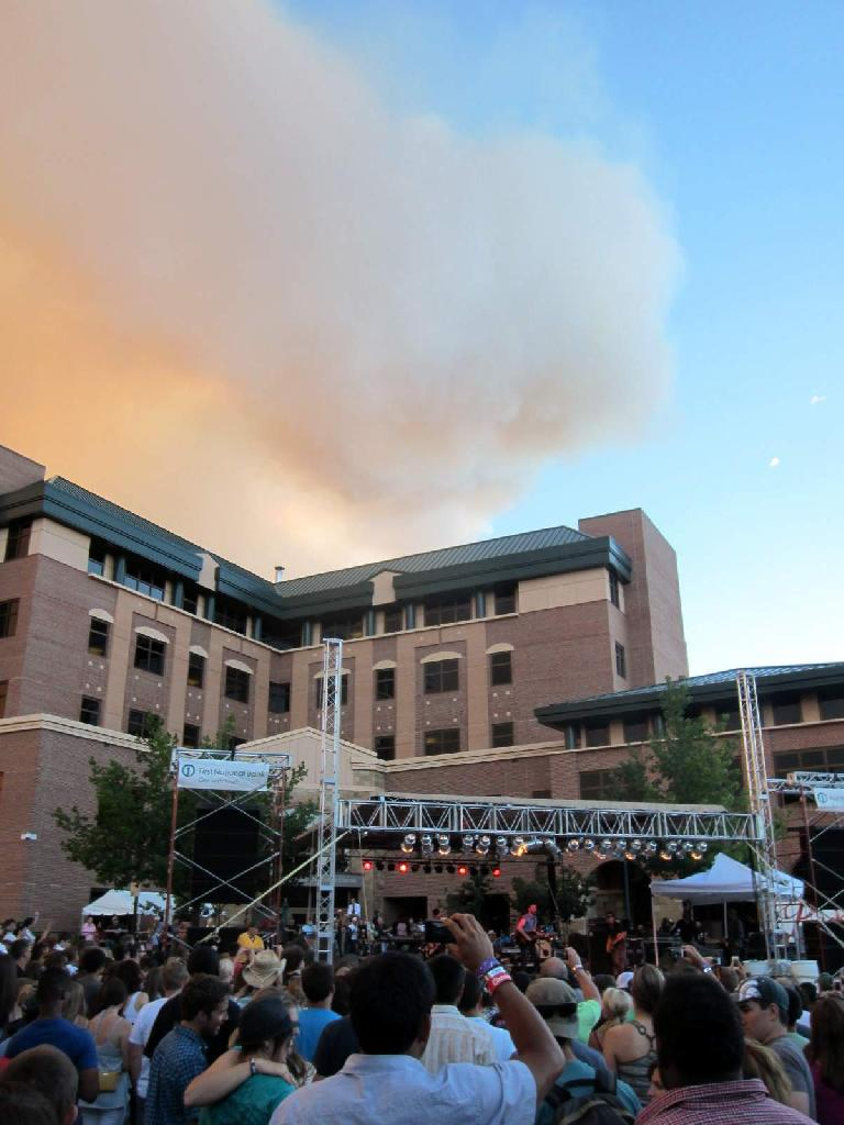 "The smoke cloud above from the High Park Fire looked like it had a smiley face while Matt Kearney sang his encore of ""Dawn."""