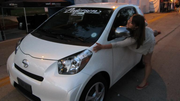 Katia hugging a Scion IQ.