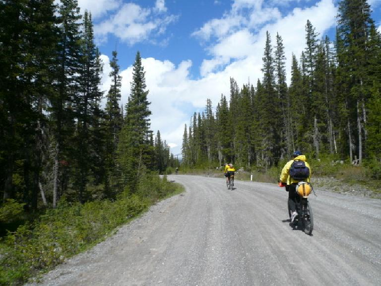 [Day 1, Mile 36] Riding with racer Kevin Hall and, briefly, Andy Buchanan (I think) on a gravel access road near Banff National Park. (June 13, 2008)