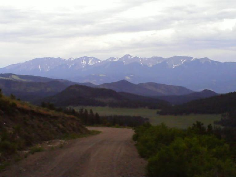 [Day 17, Mile 1767] Descent into Salida, CO with numerous Fourteeners in the distance. (June 29, 2008)