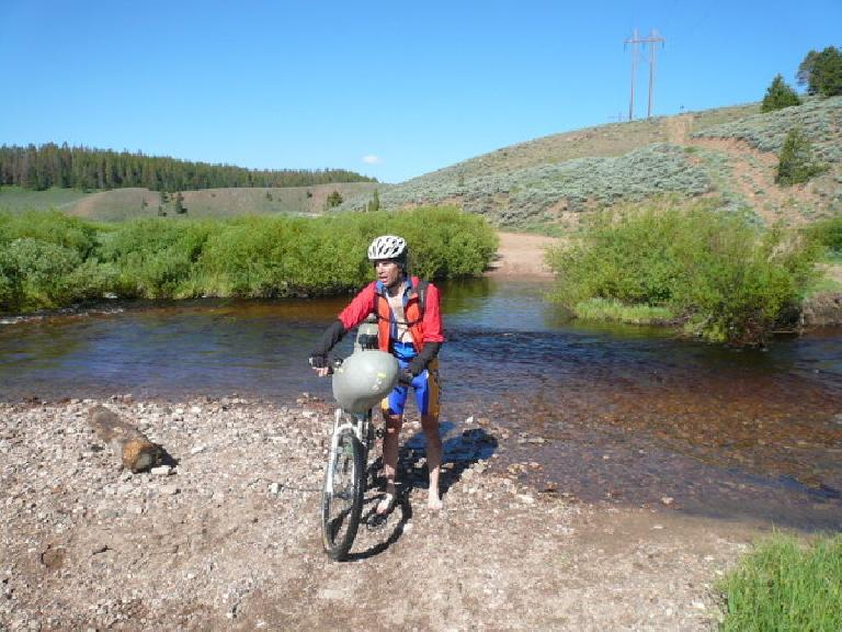 [Day 17] Had to ford a knee-deep river.  This is John Nobile (the ultimate winner of the concurrent Great Divide Race) fording it right after me. (June 29, 2008)