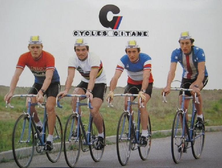 For most of his Tour de France victories, Bernard Hinault (second from the left) rode a Gitane.  This postcard is probably from around 1980. Photo: VeloClassique.com.