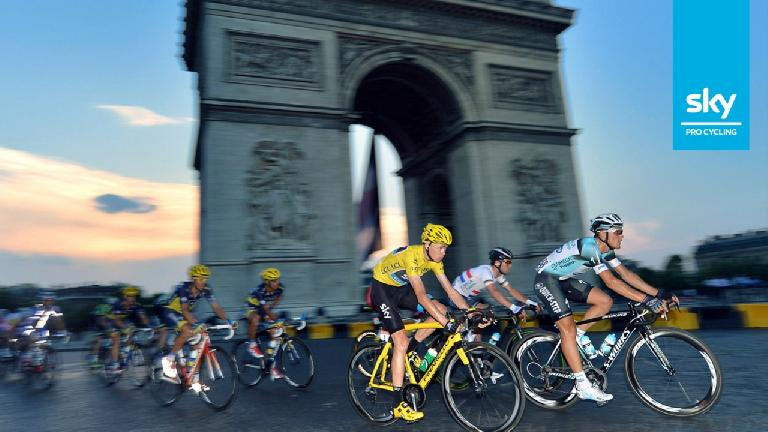Chris Froome, winner of the 2013 Tour de France, on his yellow Pinarello Dogma 65.1 Think 2. Photo: Sky Pro Cycling. (July 21, 2013)
