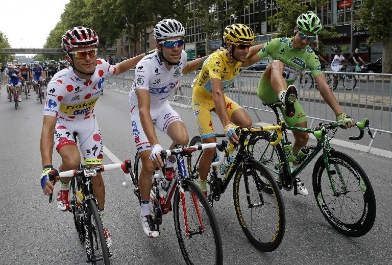 Vincenzo Nibali (in yellow) on a Specialized Tarmac during the final stage of the 2014 Tour de France. Other riders are Rafal Majka (best climber), Thibaut Pinot (best young rider), and Peter Sagan (best sprinter). Photo: Christophe Ena/AP. (July 27, 2014)