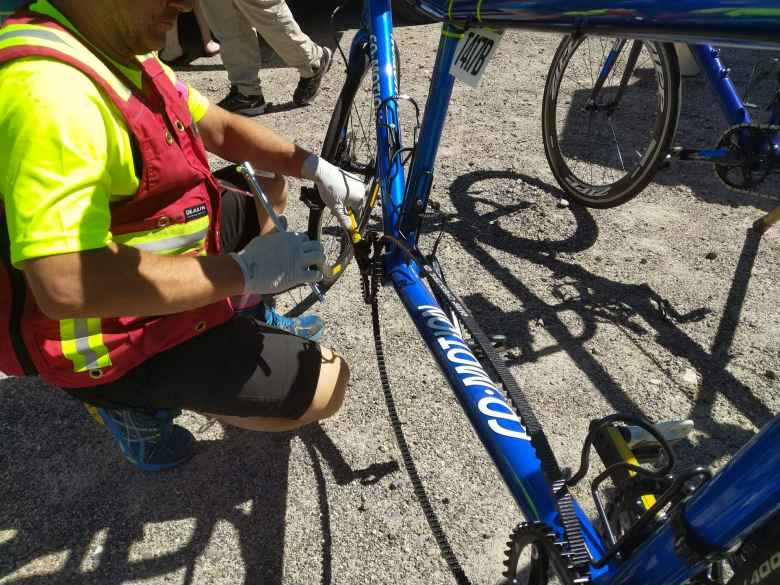 Jason Coble reattaching a crankarm that fell off on a blue tandem.