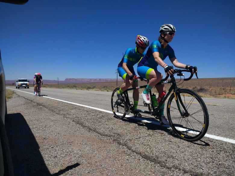Caroline Gaynor and Jack Chen ready for the relay exchange with Pamela Ferguson and Tina Ament, which occurred when the front wheel of the trailing tandem overlapped the rear wheel of the front tandem. This occurred on Highway 163 west of Bluff, Utah.