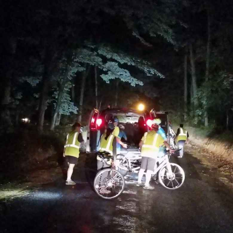 Doing an exchange on a dirt road on the last night of the race.
